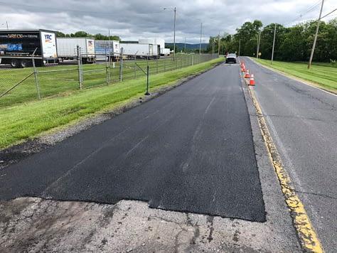roadway paving trucking for asphalt repairs